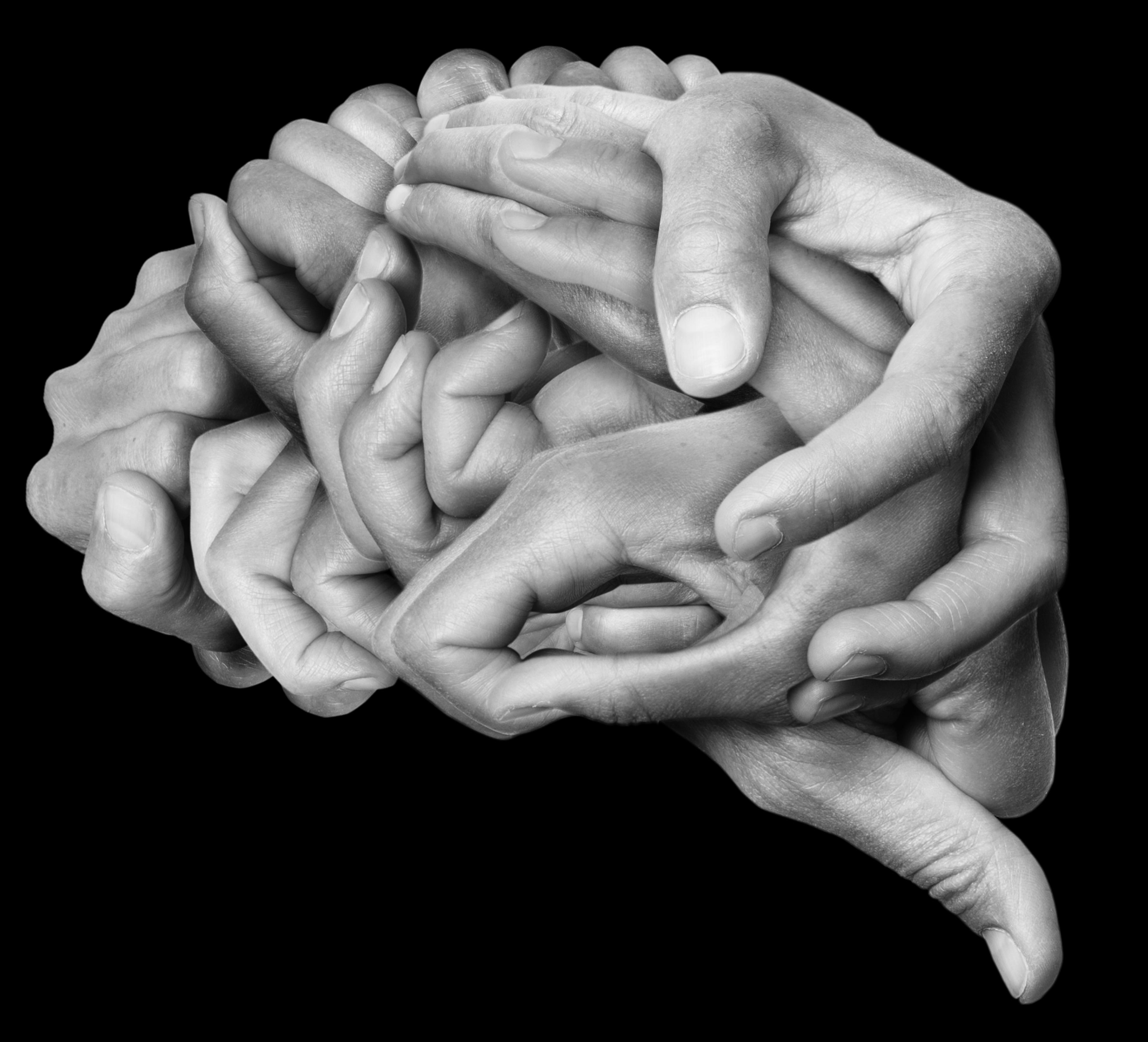 Imagen de un conjunto de manos que simulan la silueta de un cerebro